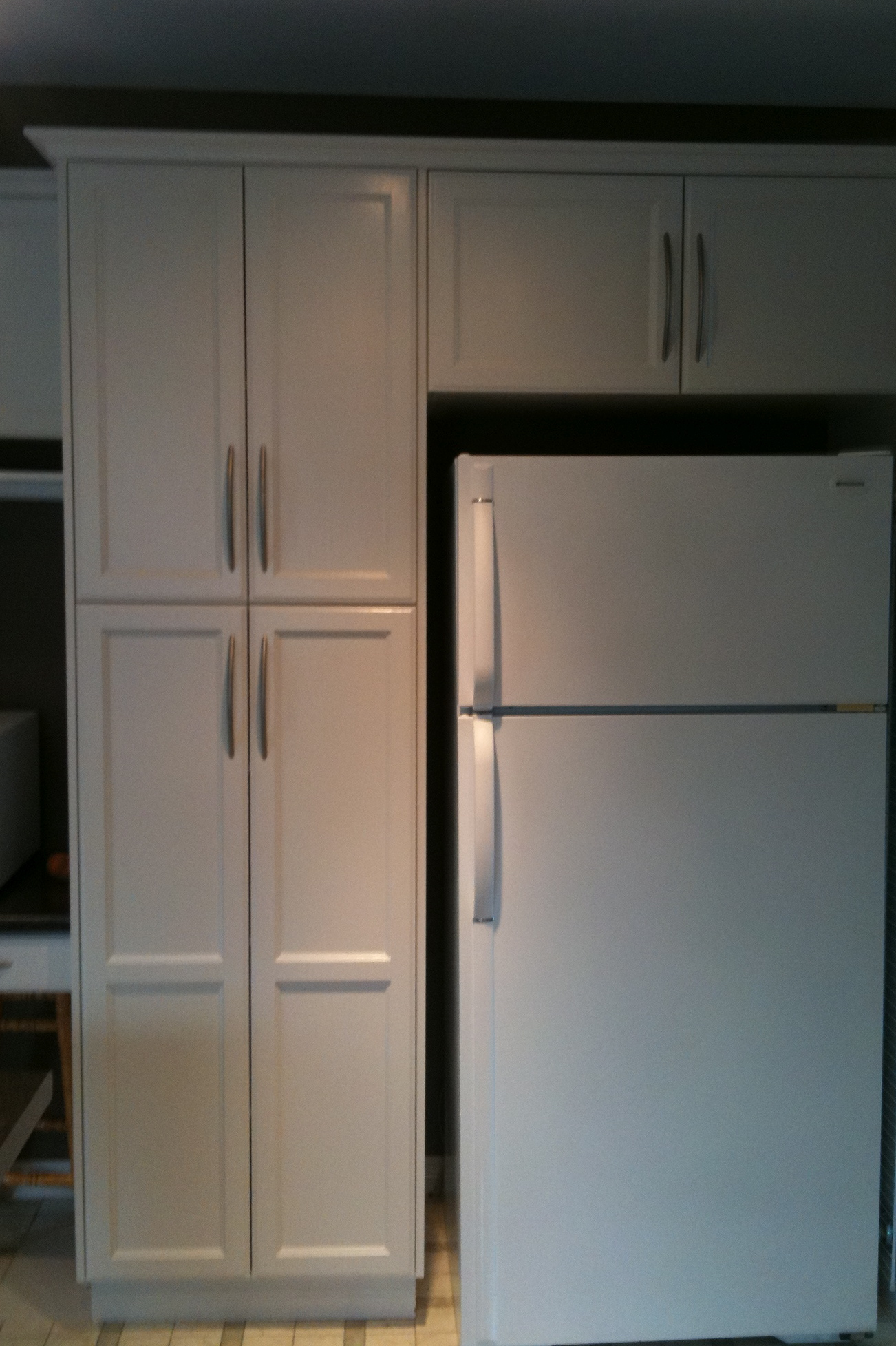 Cabinet repainting to paint or restain raelistic artistic for Best paint and primer for kitchen cabinets